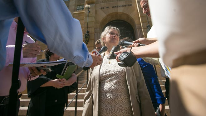 State Superintendent Diane Douglas leaves the Maricopa County Court House in Phoenix on Friday, June 26, 2015.