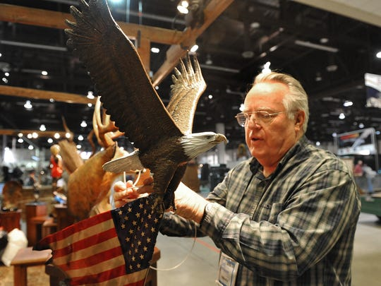 Bend, Ore. bronze sculpturer Gary Cooley secures his work Monday afternoon in preparation for Tuesday's opening of the Safari Club International's annual show at the Reno-Sparks Convention Center. Approximately 1100 exhibitors will be on hand. Photo taken 1/24/11. Photo by Tim Dunn/RGJ