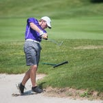 Richmond's Evan Williams chips toward the green while playing in the Bo Van Pelt/Justin Cross Richmond High School golf invite Saturday, April 16, 2016, at Elks Country Club in Richmond
