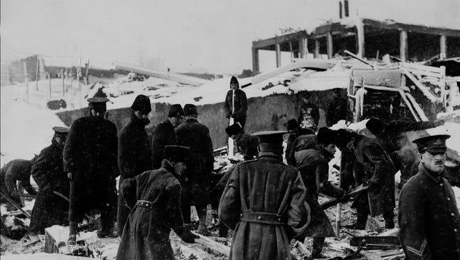 Soldiers help with rescue work at the Hollis Foundry in the aftermath of a massive explosion Dec. 6, 1917 in Halifax, Nova Scotia, that killed nearly 2,000 people.
