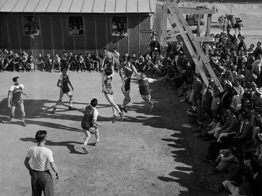 A basketball game at the Poston camp in Arizona on Jan. 2, 1943. This photo is featured in an exhibit on Japanese internment at the FDR Presidential Library and Museum in Hyde Park.