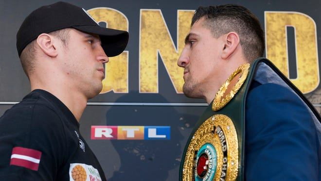 German boxer Marco Huck, right,  and Latvian boxer Mairis Briedis face off during a news conference  in Dortmund, Germany, this week. Briedis defeated Huck in a WBC cruiserweight title bout Saturday.
