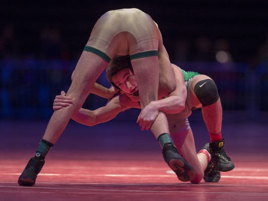 Yorktown High School's Christian Hunt wrestles with