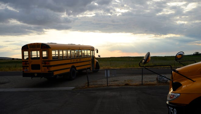 Two school buses drop off students at Park Valley School in Park Valley, UT.