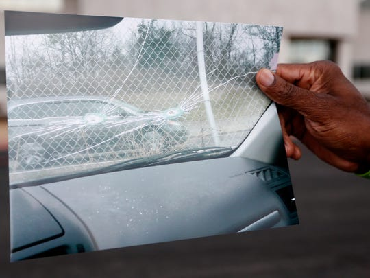 Jermaine Wooten holds a photo taken from the inside