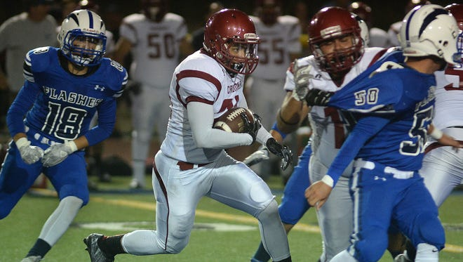 Santa Paula's Zackery Marquez looks for more running room during Friday night's rivalry game at Fillmore High.