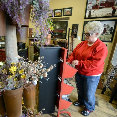 Brenda Nelson reorganizes merchandise Monday afternoon