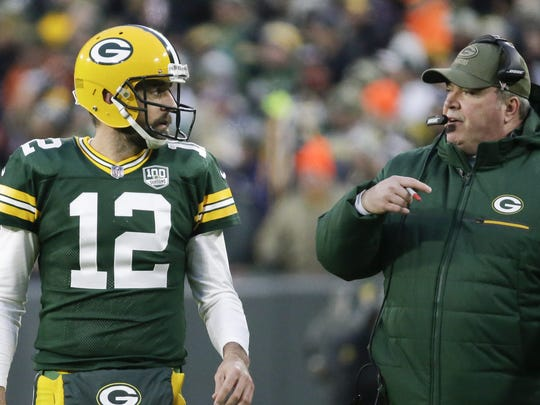 Green Bay Packers head coach Mike McCarthy talks to Aaron Rodgers during the first half of an NFL football game against the Miami Dolphins Sunday, Nov. 11, 2018, in Green Bay, Wis. (AP Photo/Mike Roemer) ORG XMIT: WIMG1