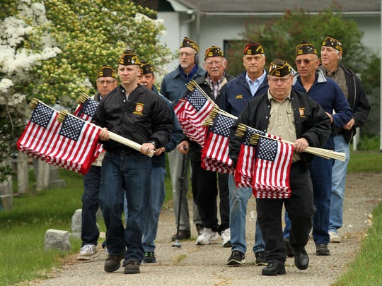 Members of Randolph Veterans of Foreign Wars Post 7333 arrive at Mount Freedom cemetery in Randolph on Thursday to place American flags on veteran graves in honor of Memorial Day. May 21, 2015.