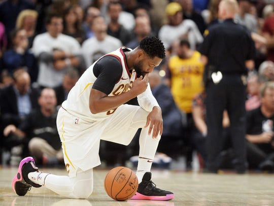 Cleveland Cavaliers guard Dwyane Wade prays after Boston