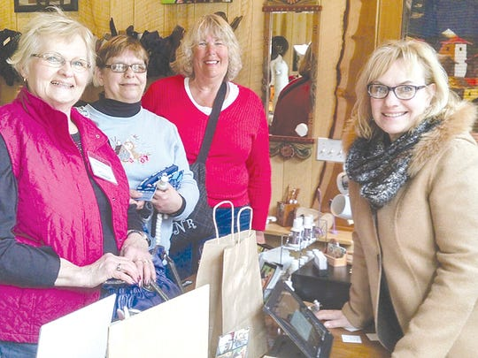 From left: Sally Knopf (Rogers City), Marie Sommers (Kinde), Laurie Norris (Hesperia), with Crystal Valley Alpaca Farm & Boutique's Chris Nelson.