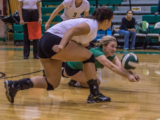 Farmington's Lexie Jackson, right, makes a diving dig