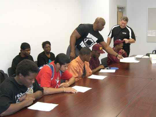 Corey Broomfield (seated, far right) signed his letter-of-intent with Mississippi State in February of 2008 with (from left) Jiminez Serdiney, Michael Maldonado, Xavier Gowins and Maurice Francois. In back, then-coach Mike Davis helps out and to the right of him is then-Bayside A.D. Greg McGrew.