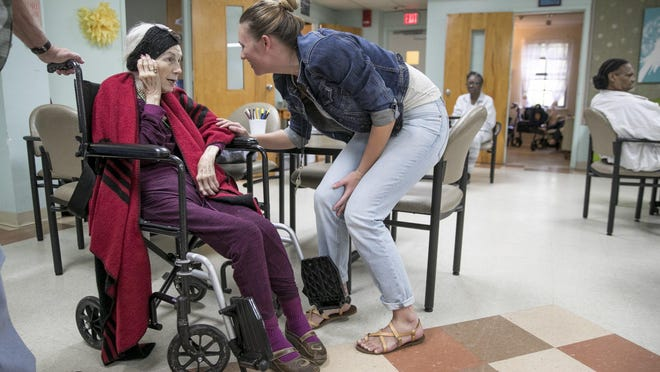 Activity assistant Holly Stoever, right, talks to Jeanelle Roddy at AGE of Central Texas Adult Day Health Center in 2019.