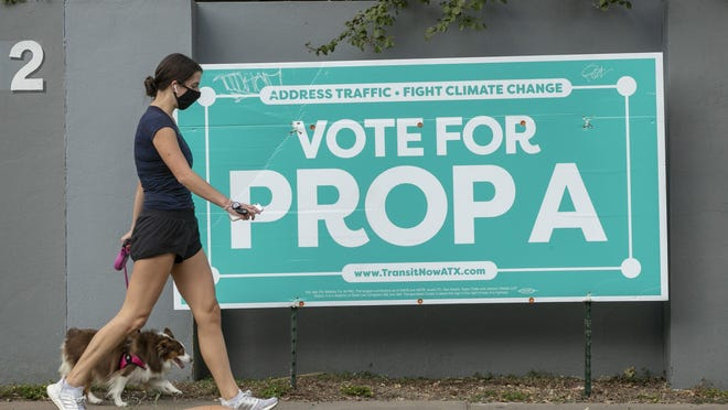 A campaign sign urging voters to approve Proposition A is posted on West 24th Street in Austin's West Campus neighborhood on Friday. Proposition A calls for a permanent increase to the city of Austin's property tax rate to fund a $7.1 billion mass transit system, in what Capital Metro has referred to as an initial investment.