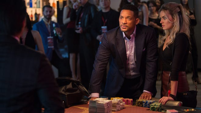"Will Smith is a veteran con man thrown off his game when his former lover and protege (Margot Robbie, at right) unexpectedly appears and interferes with his latest dangerous scheme in ""Focus."""