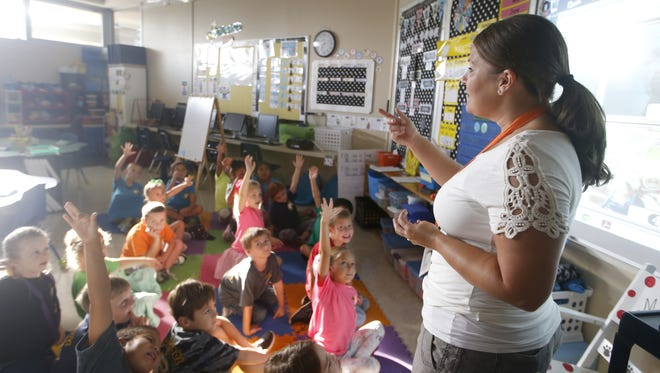 First grade teacher Kari Mullins calls on students during a morning lesson plan in her classroom.