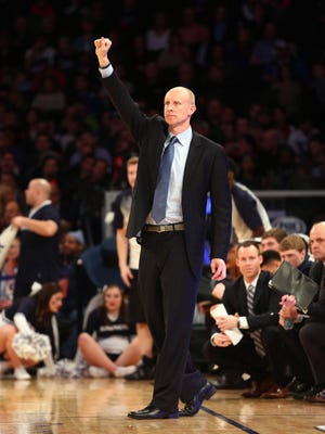 Xavier head caoch Chris Mack gestures from the sidelines during Saturday's game against Villanova.