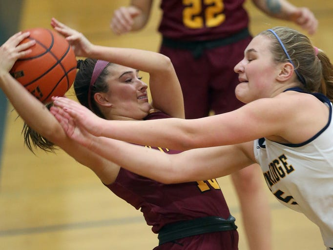 Kingston's Elise Hiner (left) yanks the ball out of
