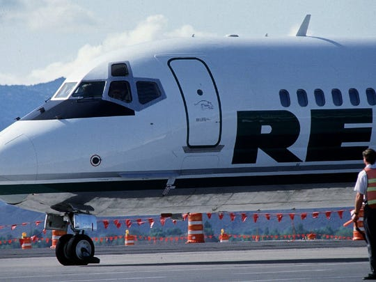 Reno Air's first flight, above, arrives at Reno Tahoe International Airport on July 1, 1992. The airline operated until 1999, when it was purchased by American Airlines.