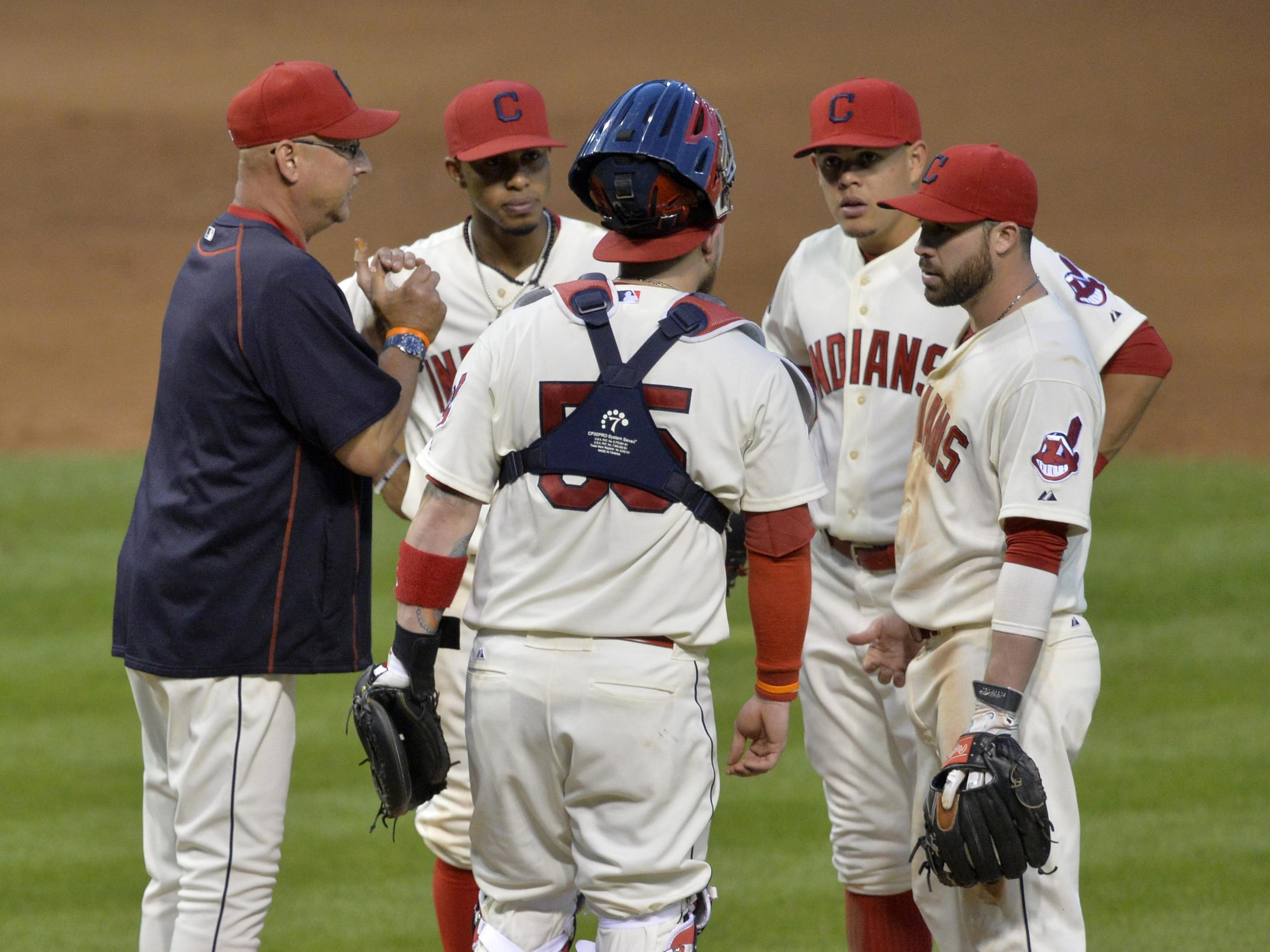 Cleveland Indians manager Terry Francona (left) stands on the mound during a pitching change in the eighth inning against the Oakland Athletics at Progressive Field.