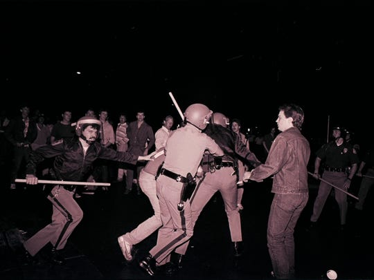 Despite a calm beginning, Cedar Fest got a bit rough on May 17, 1986. A partygoer is arrested by undercover police for throwing bottles at police officers.