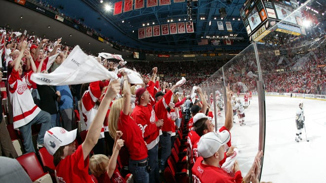 Red Wings fans cheer and wave good-bye to the Penguin players as they leave the ice after the Wings' 3-1 victory in Game 2 of the 2009 Stanley Cup finals at Joe Louis Arena. Pittsburgh would win the series in seven games.