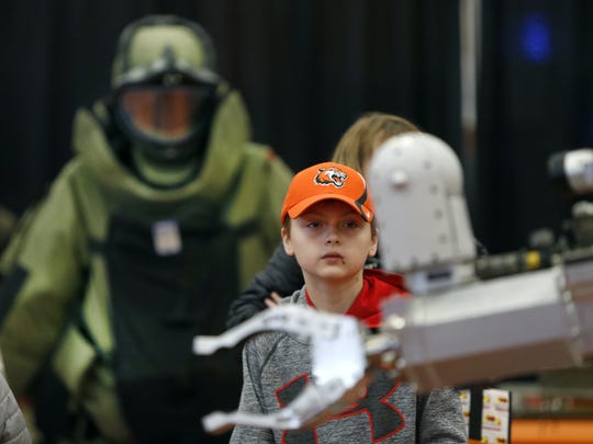 Nick Maclean, 12, of Farmington watches an Air Force bomb disposal robot during Imagine RIT 2017 at the Gordon Field House and Activities Center in the Rochester Institute of Technology.