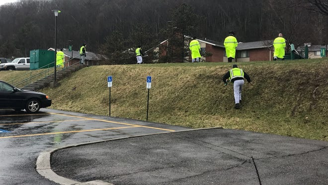 Police conduct a search in the Susquehanna Community of the Binghamton University Campus on April 16, 2018, the morning after the fatal on-campus stabbing of 19-year-old freshman Joao Souza.