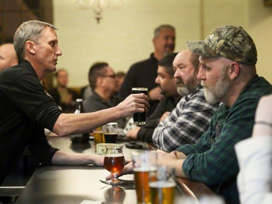 Co-owner Jim Waller tends bar at Black Cap Brewing Company.