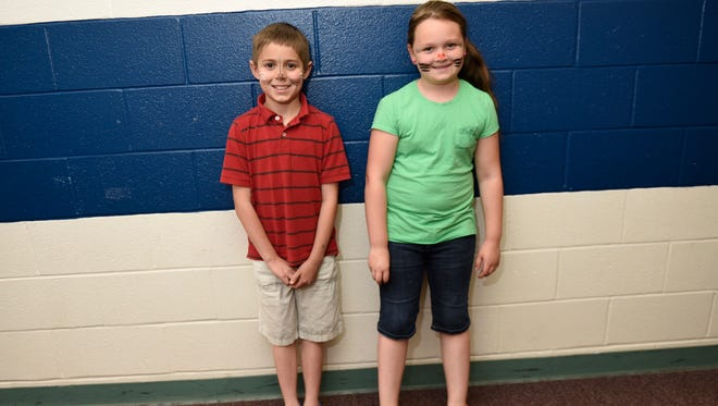 Third-graders Madelyn Predko and Jeremy Gelwicks, South Hamilton Elementary School students, wear attire permitted in the now-former dress code of Chambersburg Area School District. Next year these students can return to school with graphics on their shirts - something they haven't been allowed to do since kindergarten.