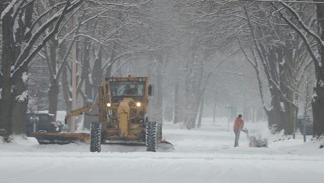Green Bay residents clean up after overnight snow, Saturday morning.