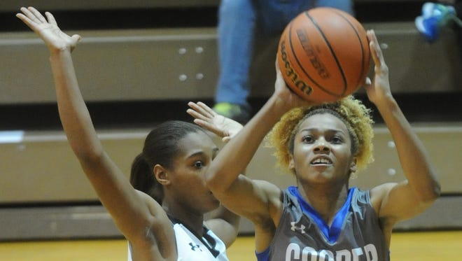 Cooper's Calah Harvey (13) drives for a shot as Denison's Ikia Lacy defends. Denison beat Cooper 47-45 in overtime in a seeding game at the Polk-Key City Classic on Thursday, Nov. 17, 2016 at Abilene High''s Eagle Gym.