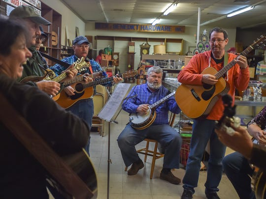 People gather inside Beck and Benedict Hardware store in Waynesboro, Pa. for a jam session on Friday, Dec. 18, 2015.