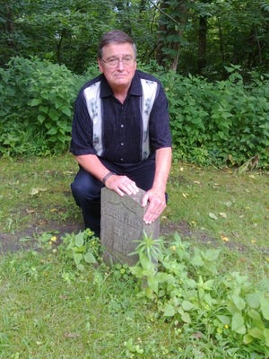 Tallahassee Author James Huffstodt at the graveside of his Civil War great-grandfather who was wounded in the war.