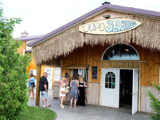 Customers line up to purchase slushies at the slushie hut at  theThree Brothers Wineries and Estates near Geneva on July 15.