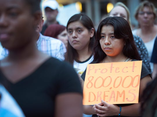 Nancy Garcia-Marquez attends a vigil for Dreamers in response to Trump's announcement to end DACA outside of the Peace Center in Greenville on Tuesday, September 5, 2017. Garcia-Marquez, who is in the DACA program, moved to the U.S. when she was 11.