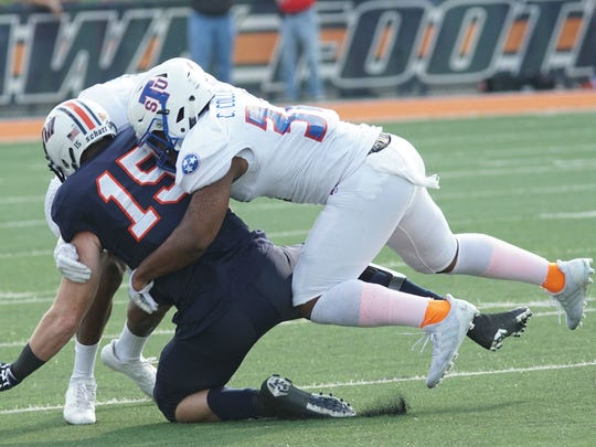 Tennessee State middle linebacker Chris Collins (32)