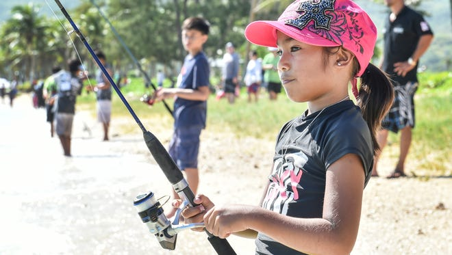 Over 50 young participants enjoy a morning of fishing at the 2015 Fishing Derby for Kids in Asan on Aug. 29.