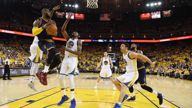 Cleveland Cavaliers forward LeBron James (23) looks to shoot against Golden State Warriors forward Kevin Durant (35) in the second half of the 2017 NBA Finals at Oracle Arena.