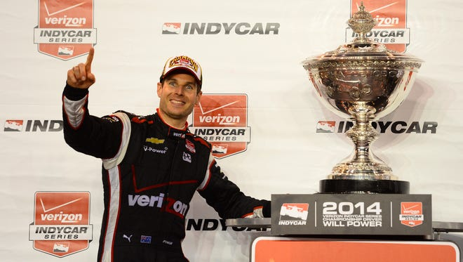Will Power poses with the championship trophy after winning the IndyCar title in 2014.