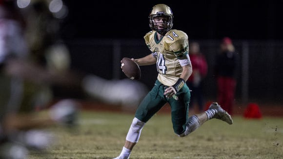 Basha quarterback Ryan Kelley looks to pass against Brophy in the first quarter at Basha High School on Thursday, Oct. 29, 2015 in Chandler, AZ.
