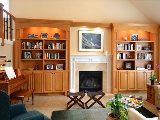 Custom-built wall units can provide endless storage for books, CDs, DVDs, works of art and other family treasures.