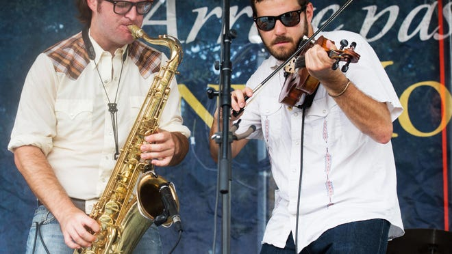 Chris Miller, left, and Daniel Coolik of the Revelers perform at the 2014 Festivals Acadiens et Creoles.