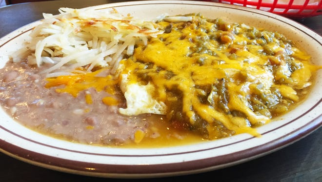 Green chile Huevos Rancheros ($6.50) with a side of hash browns and beans.