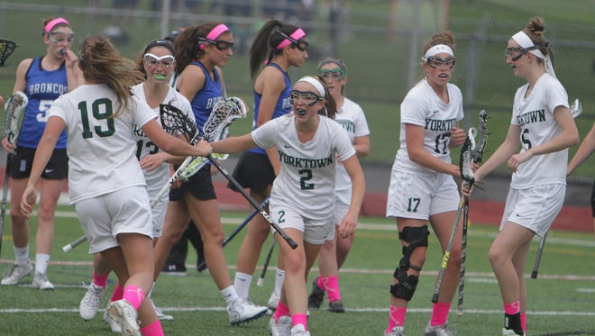 Yorktown celebrates after scoring goal during the first half of a Section 1 girls lacrosse game between Yorktown and Bronxville at Charlie Murphy Field at Yorktown High School on Monday, May 2nd, 2016. Yorktown won 12-7.