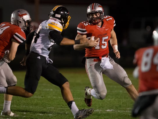 City High quarterback Nate Wieland (15) runs in the