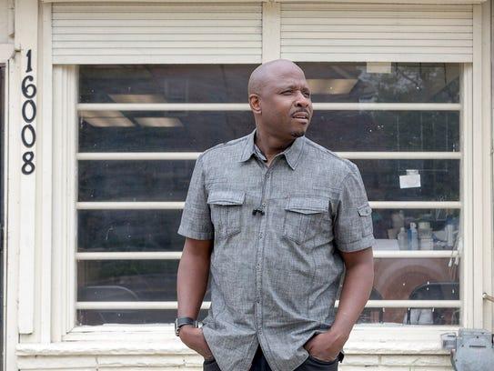 Rodney Gyson, owner of Lavish Styles -N- Cuts, poses