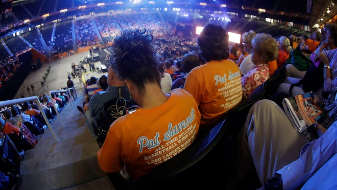 People wait in Thompson-Boling Arena for the start of a ceremony to celebrate the life of former Tennessee women's basketball coach Pat Summitt Thursday, July 14, 2016.
