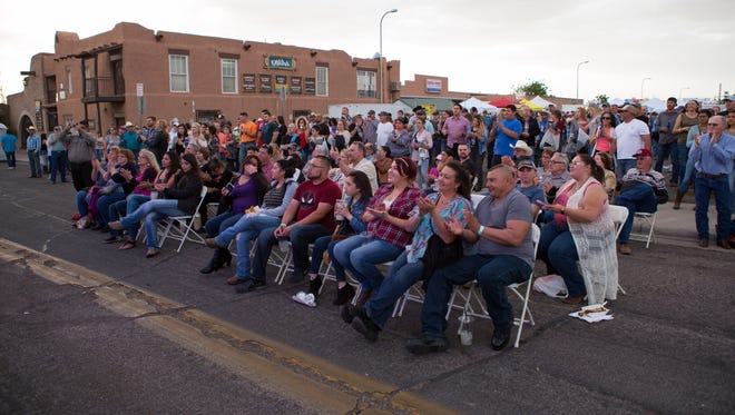 The crowd at the south stage cheer for the band at the Las Cruces Country Music Festival on April 28, 2017.